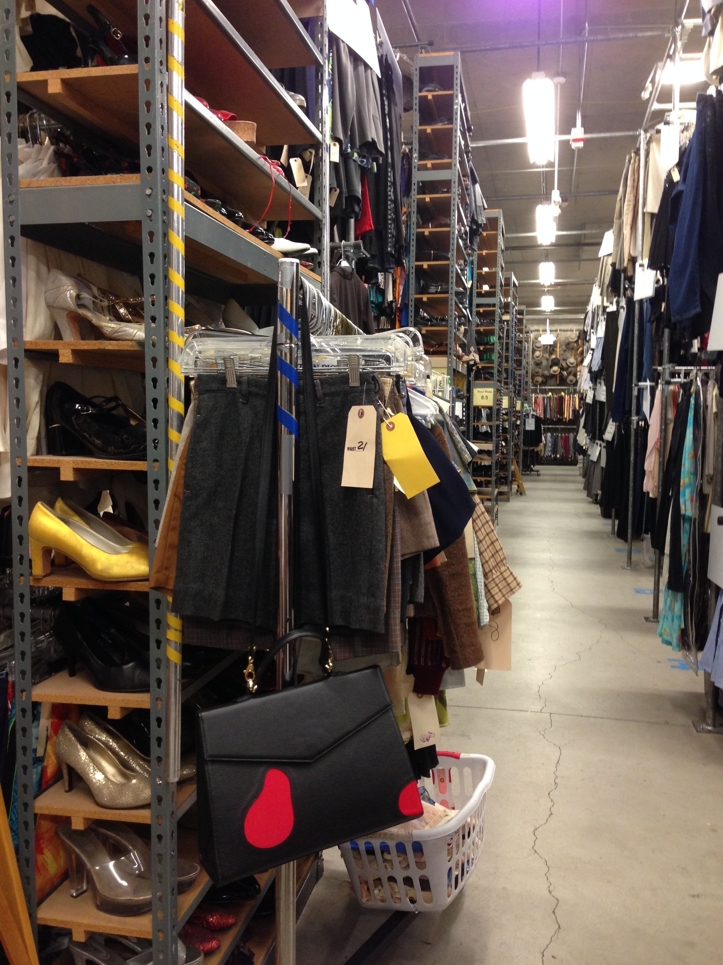 My workday often involves me pulling from a costume house.  This is Warner Bros. Costumes and there are racks and racks of clothes and accessories from all eras.