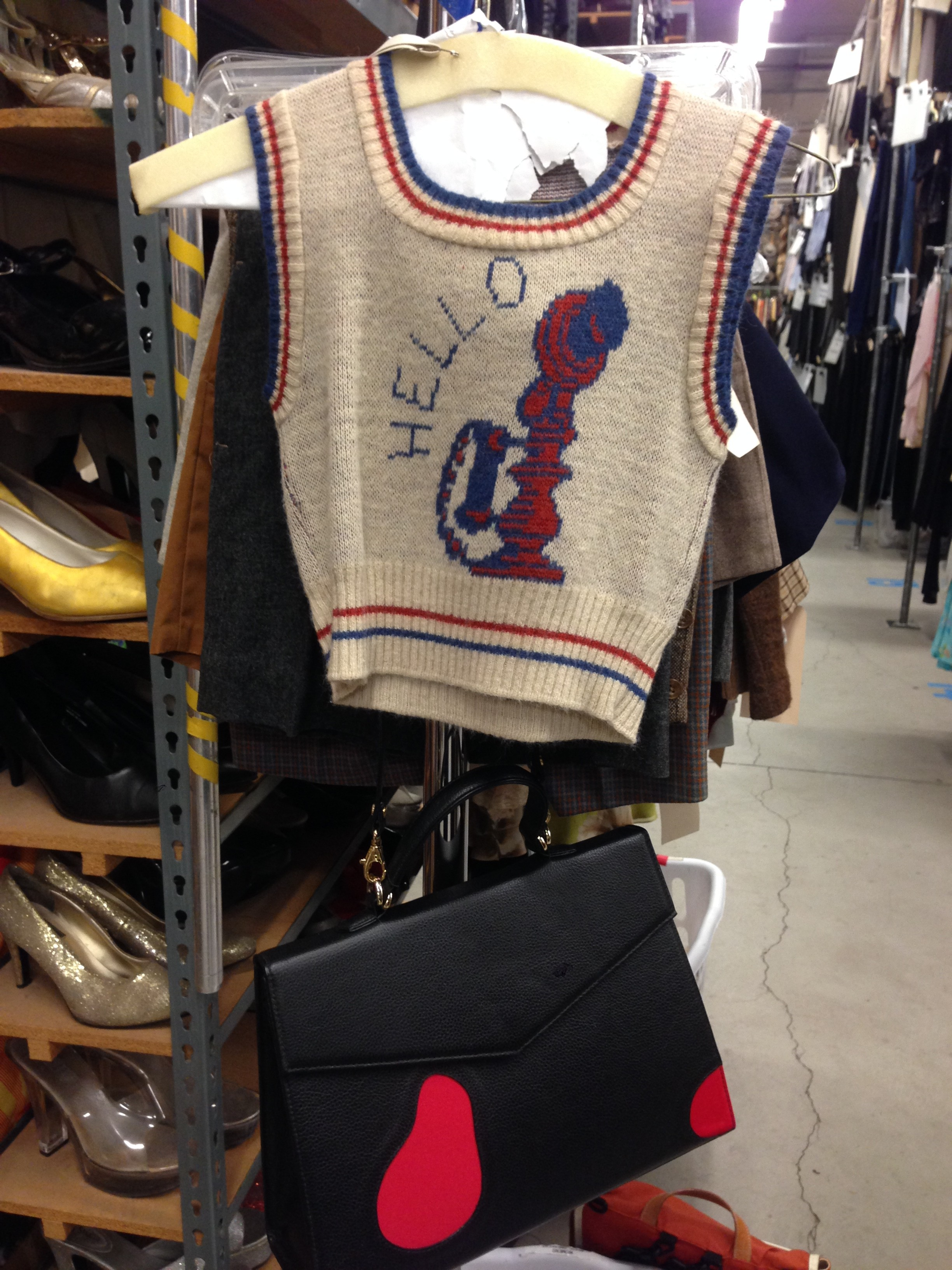 Sometimes I find cool pieces that I hope I can put someone in like this sweater vest.