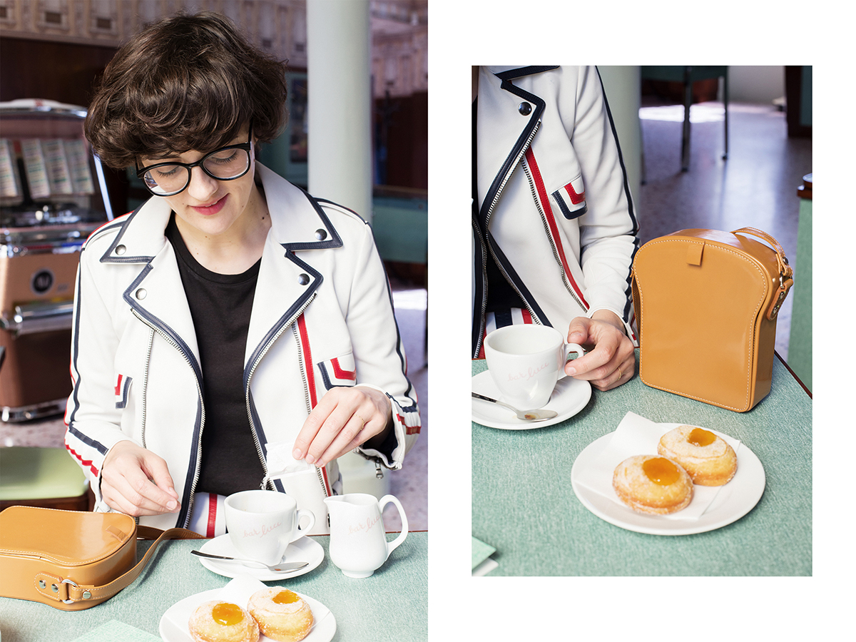 This is me having breakfast on a Thursday morning at Fondazione Prada's Bar Luce designed by Wes Anderson. Those krapften are filled with apricot jam and they look a bit erotic.