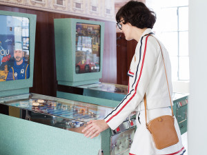 """The bar has two pinball machines inspired by Wes Anderson's movies. The pink jukebox was playing Rita Pavone's """"La Partita di Pallone."""" I didn't have any coins so I'm just pretending to play."""